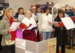 Carol singing at Sainsbury's